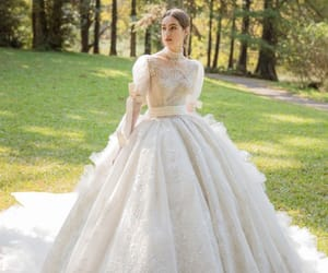 ball gown, long sleeve, and bow image