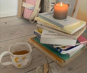 books, candle, and tea image