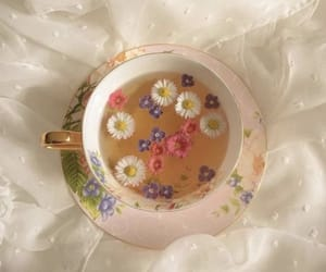 flowers, tea cup, and fairycore image