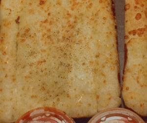 bread, movie night, and cheesy bread image