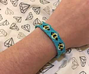 bee, blue, and bracelet image