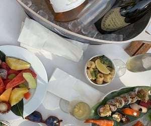 champagne, sushi, and beverage image
