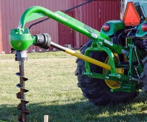 farmer, tractor, and auger image