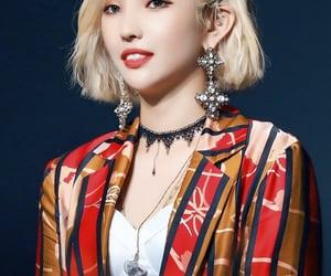 minnie, yuqi, and soyeon image