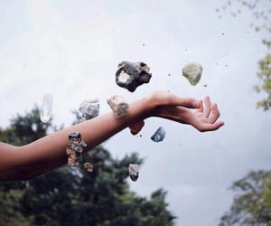 hand and stone image