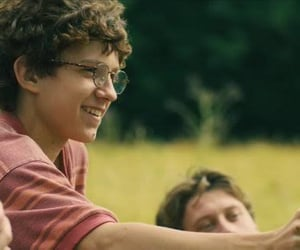 isaac, tom holland, and movie image