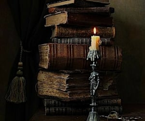 candle, old books, and dark academia image