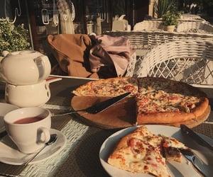 enjoying some pizza