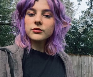 dyed hair, elf ears, and makeup image