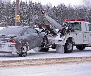 tow truck service, cheap tow trucks, and cheap towing service image