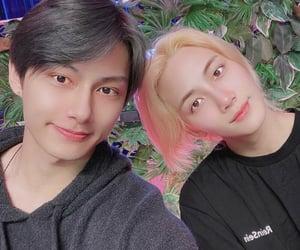 wen junhui, yoon jeonghan, and moon junhui image
