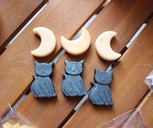 black cat, crescent moon, and Halloween image