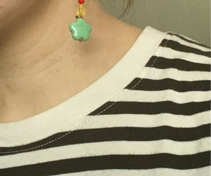 earring, hairstyle, and shirt image