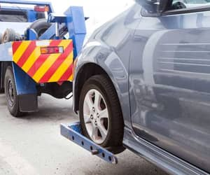 cheap towing service, cheap towing near me, and tow truck service image