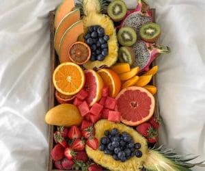 berries, blood orange, and pineapple image
