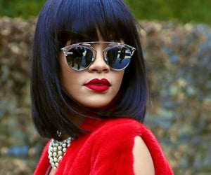 Rihanna in red Dior coat