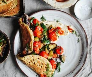 hummus, roast tomato, and vegetarian image