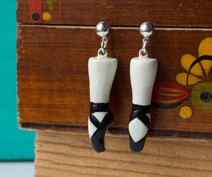 black swan, black white, and earrings image