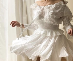 dress, pearls, and twirl image