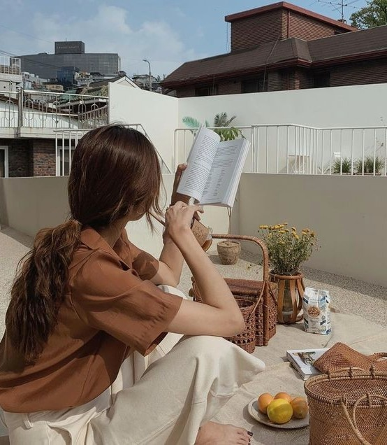 book, hairstyle, and low image