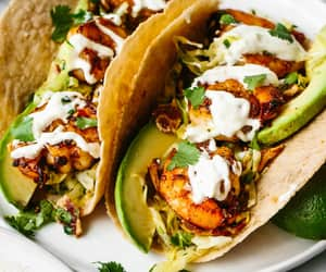 Shrimp Tacos With Cilantro Lime Bacon Slaw Recipe. These shrimp tacos are a flavor explosion! They strike the perfect balance between spicy shrimp, crisp & tangy slaw, & creamy avocado. With so much flavor, I guarantee you'll make this shrimp taco recipe.