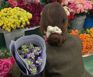 brunette, bun, and flowers image