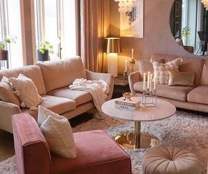 chandelier, interior design, and sofa image