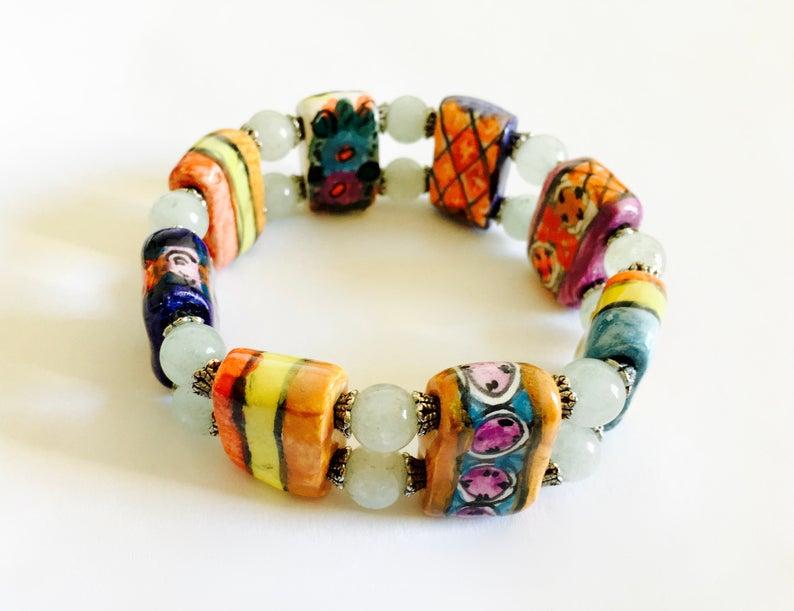 bright colors, vintage jewelry, and orange black image