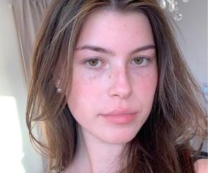 brown eyes, brown hair, and eyebrows image