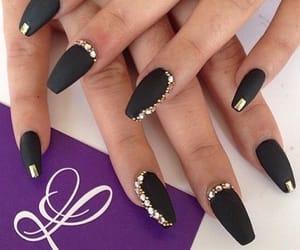 black and gold nails image