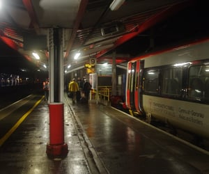boarding, commuter, and rain image