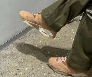 streetwear, beige shoes, and leather trousers image
