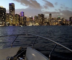 city lights, nights, and ocean image