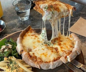 cheese, pizza, and delicious image