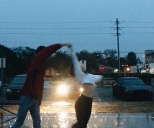 couple, love, and rain image