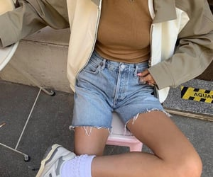 leather jacket, everyday look, and white sneakers image