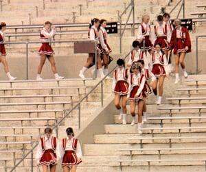 Cheerleaders, high school, and football image