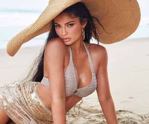Kylie Jenners with oversized sunhat and knit bikini on the beach