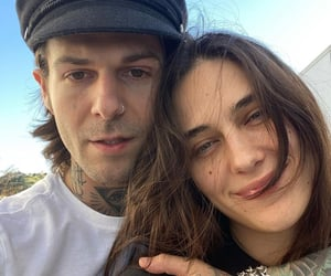 jesse rutherford, devon lee carlson, and baby image