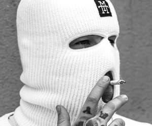 balaclava, cigarettes, and ink image