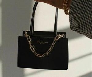 black, gold, and bag image