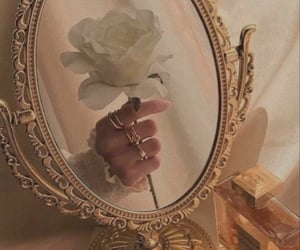 flowers, mirror, and book image