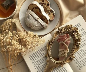 book, mirror, and flowers image