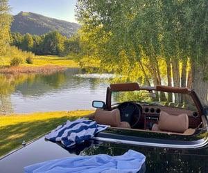 car and lake image