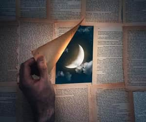 book pages, clouds, and hand image