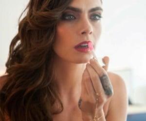 curls, gloss, and lipstick image