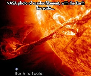 nasa photo, solar filament, and w earth for scale image