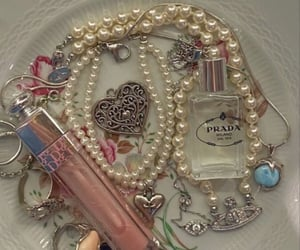 collar, lipstick, and makeup image