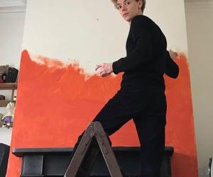 black, orange, and painting image
