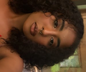 brown, curly hair, and eyes image